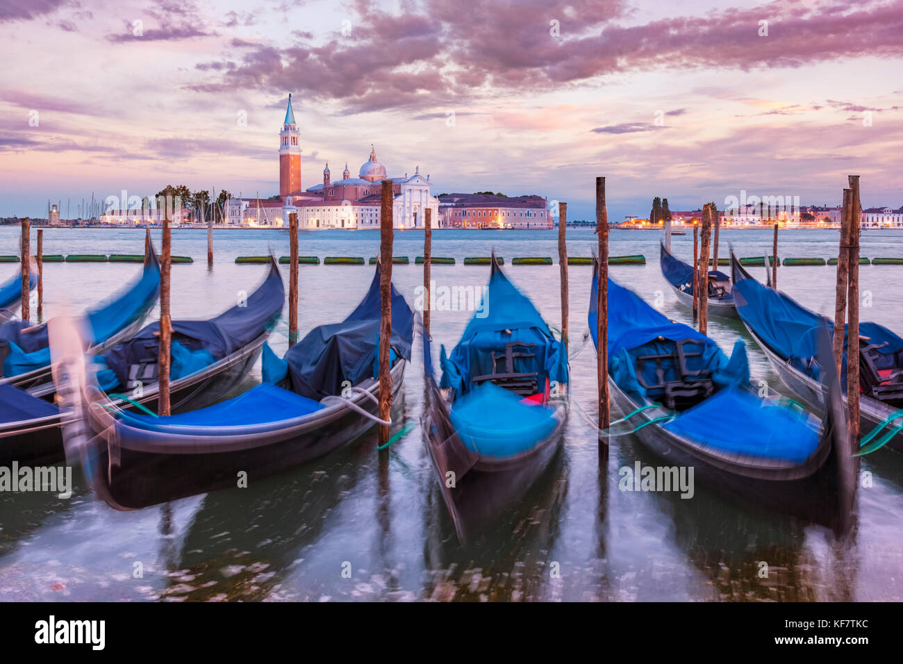 Gondolas Italy venice italy moored gondolas on the Grand Canal Venice opposite the Island of San Giorgio Maggiore - Stock Image