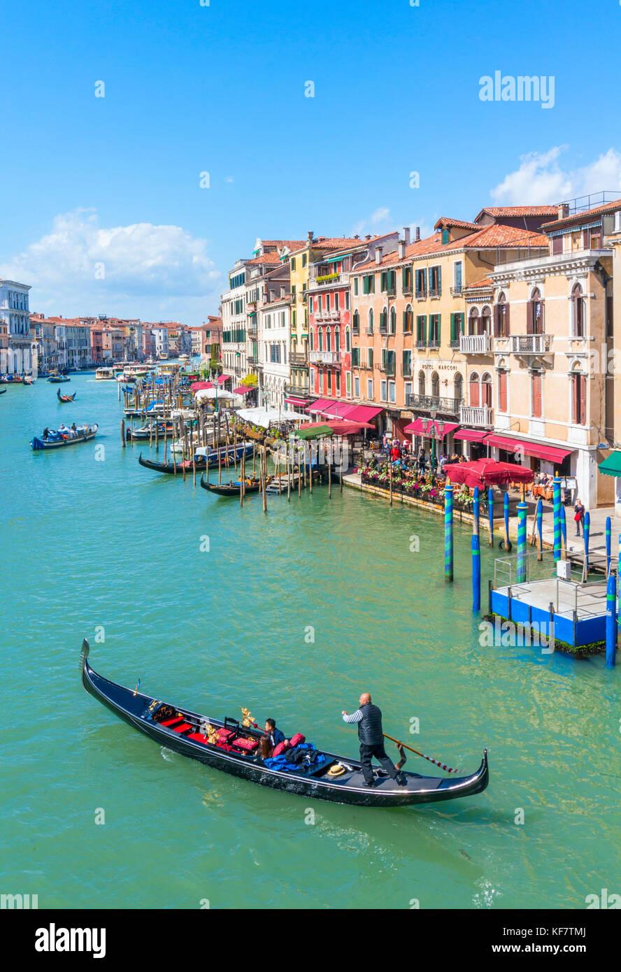 VENICE ITALY VENICE Gondolier rowing a gondola full of tourists on a gondola ride on the grand canal Venice Italy - Stock Image