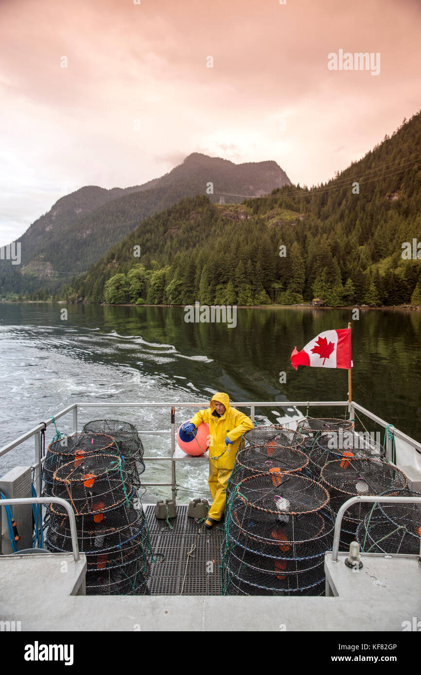 CANADA, Vancouver, British Columbia, portrait of first mate Frank Keitsch, Spotted Prawn fisherman, aboard the boat - Stock Image