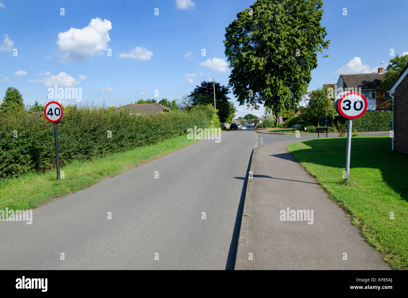 Contraditctory speed limit signs entering a village (Boughton Monchelsea) in Kent, England - Stock Image