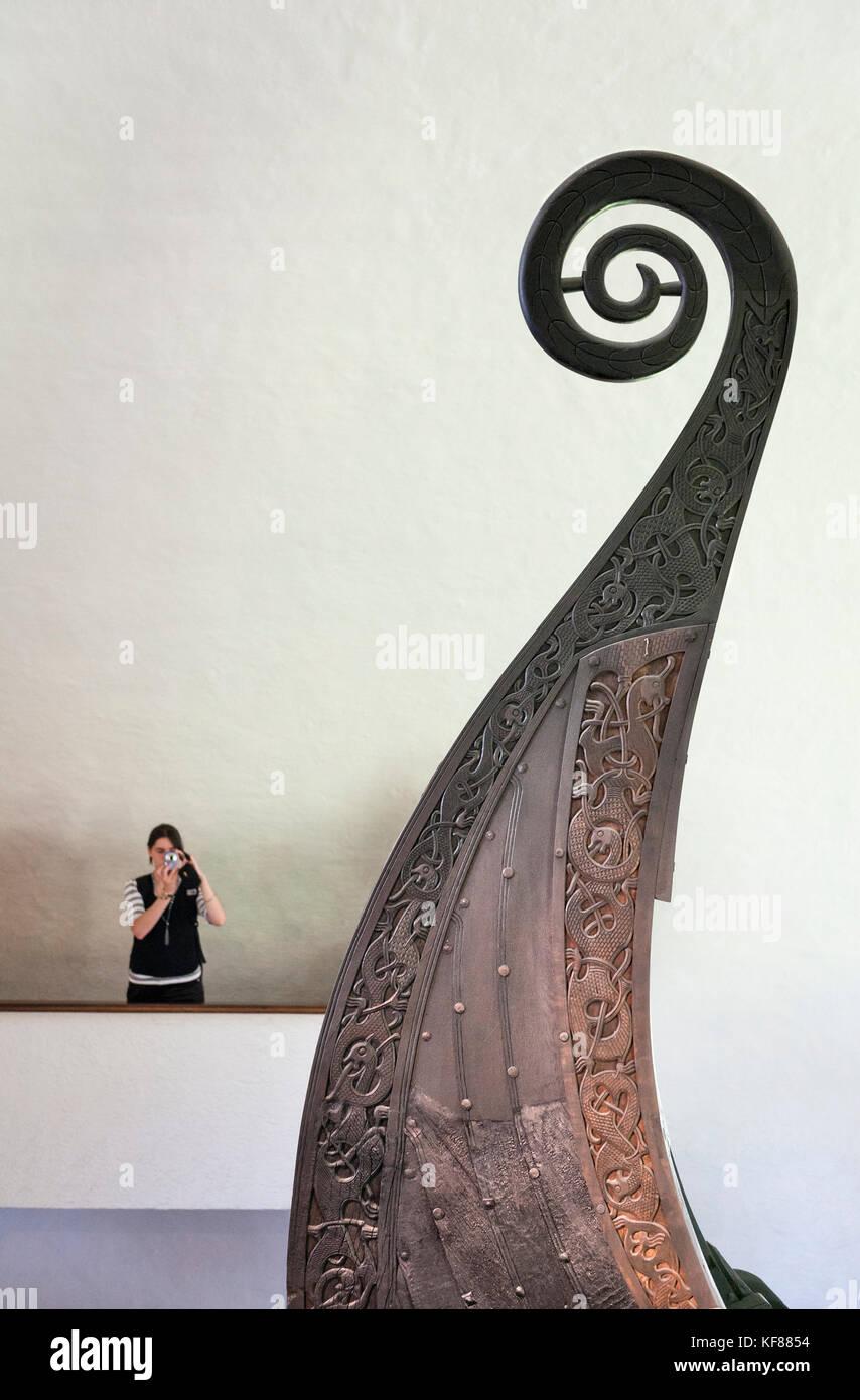 Oslo, Norway. The Viking Ship Museum (Vikingskipshuset på Bygdøy). Elaborate dragon carvings decorate - Stock Image