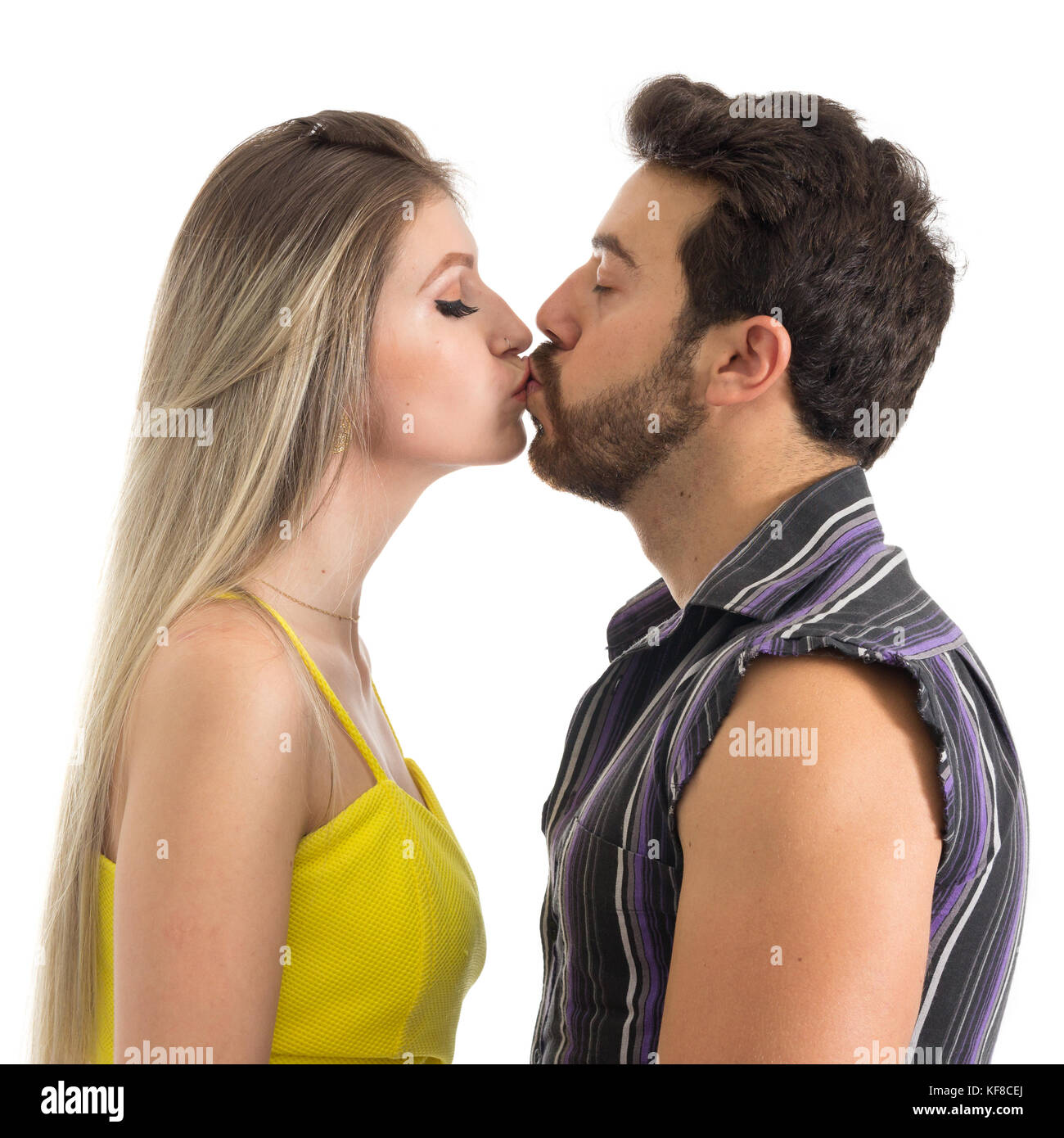 2e404893 Girlfriend and boyfriend kissing each other. A couple in love is kissing  gently. Profile face, white background. Romance.