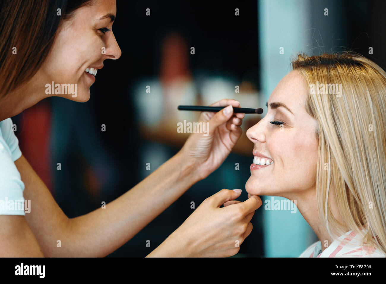 Portrait of beautiful woman getting cosmetic care at beauty salo - Stock Image