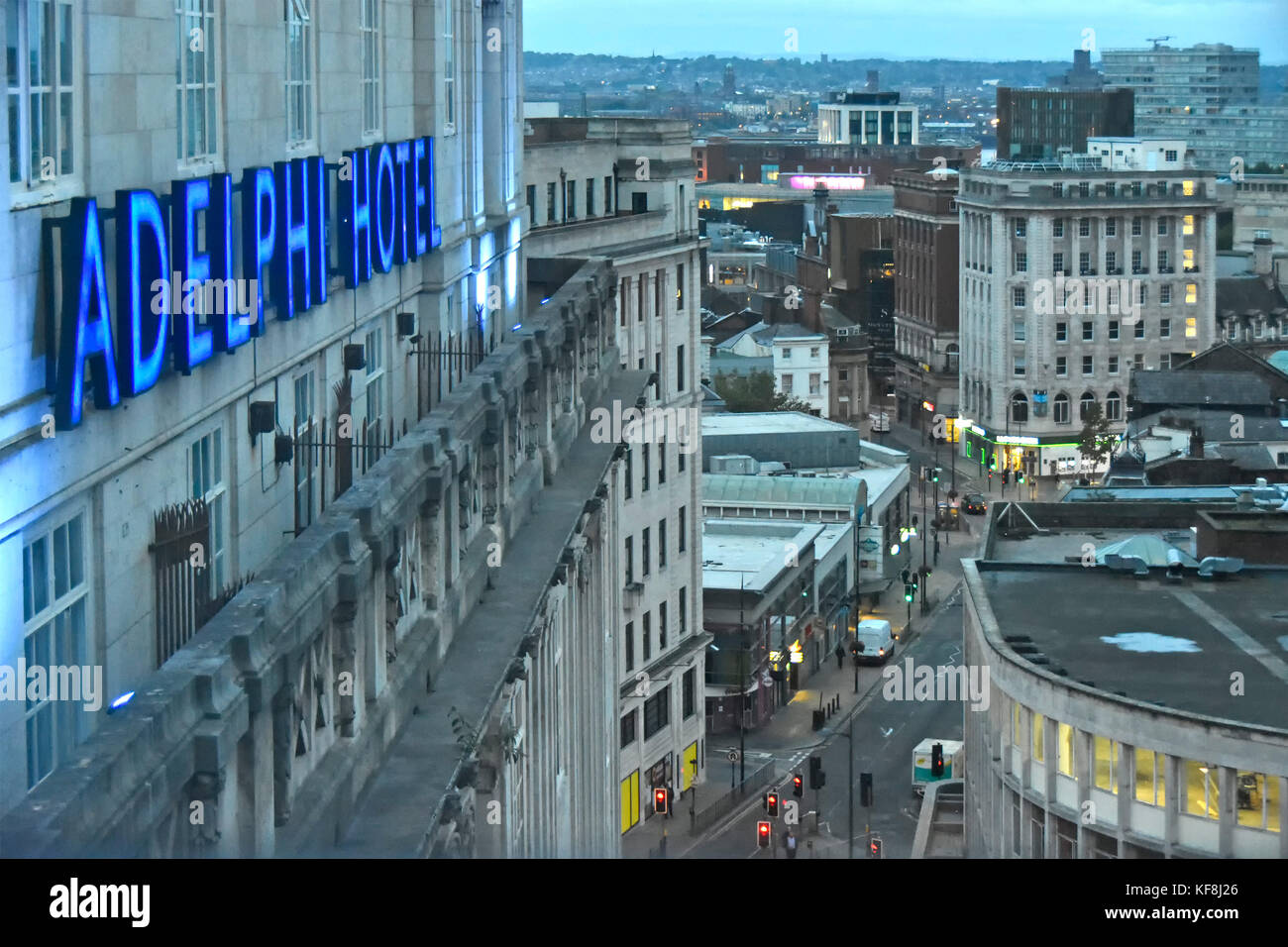 Early morning dawn view looking down from above at Liverpool city centre streets blue neon sign for Britannia Adelphi Stock Photo