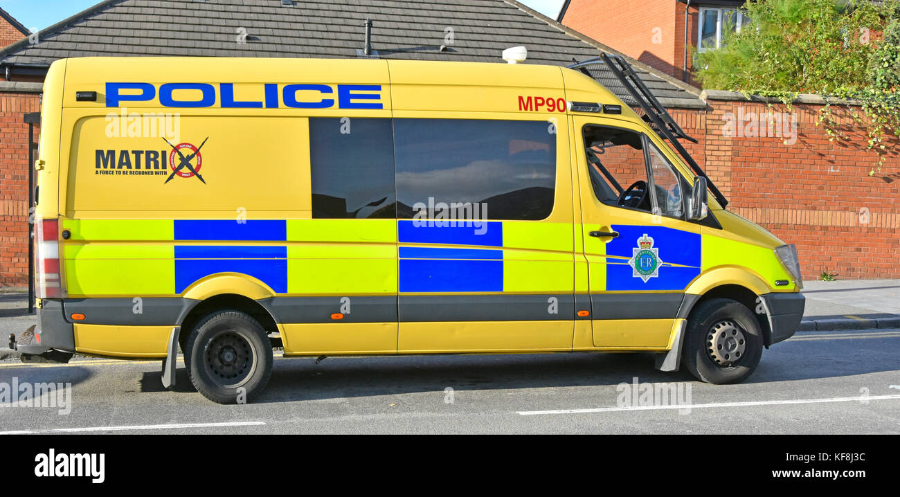 Merseyside police public order Matrix disruption team patrolling in Liverpool in yellow Mercedes Sprinter van fitted - Stock Image