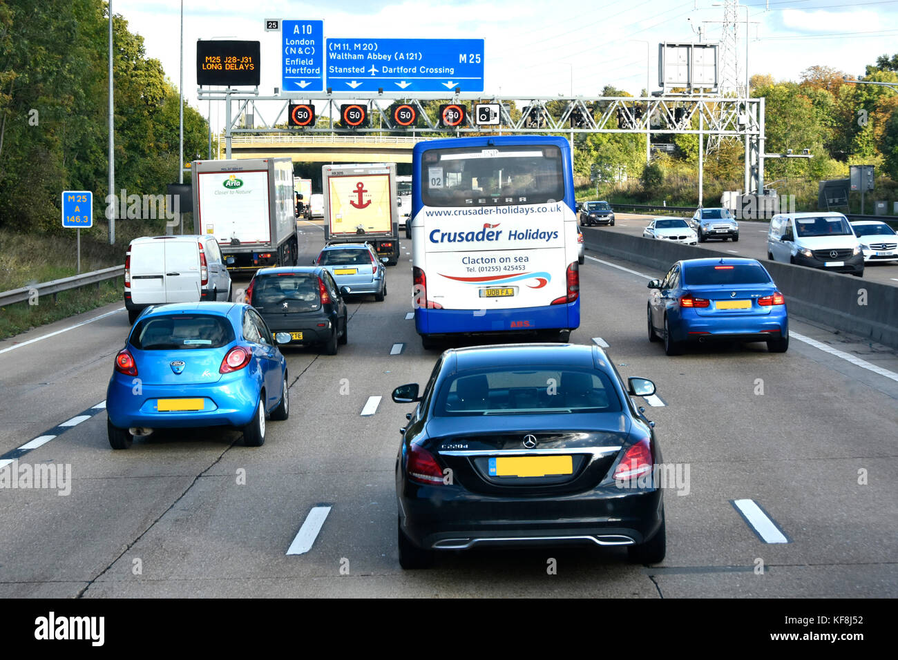 Friday PM rush hour M25 motorway traffic junction 25 & electonic variable speed signs set at 50 MPH & electronic - Stock Image