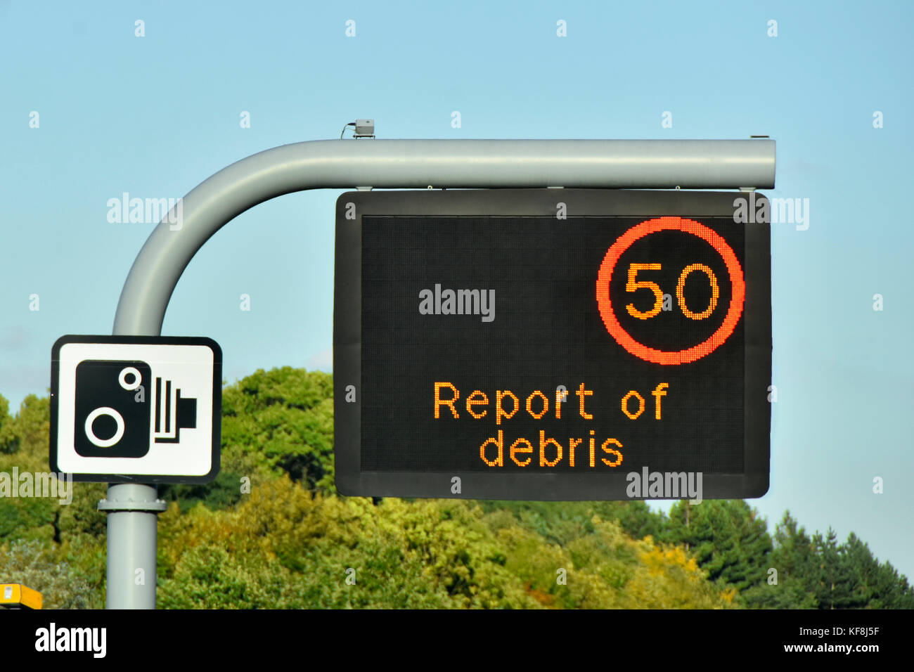 Single panel M25 motorway sign above lane one only, variable speed limit & short debris warning message complete - Stock Image
