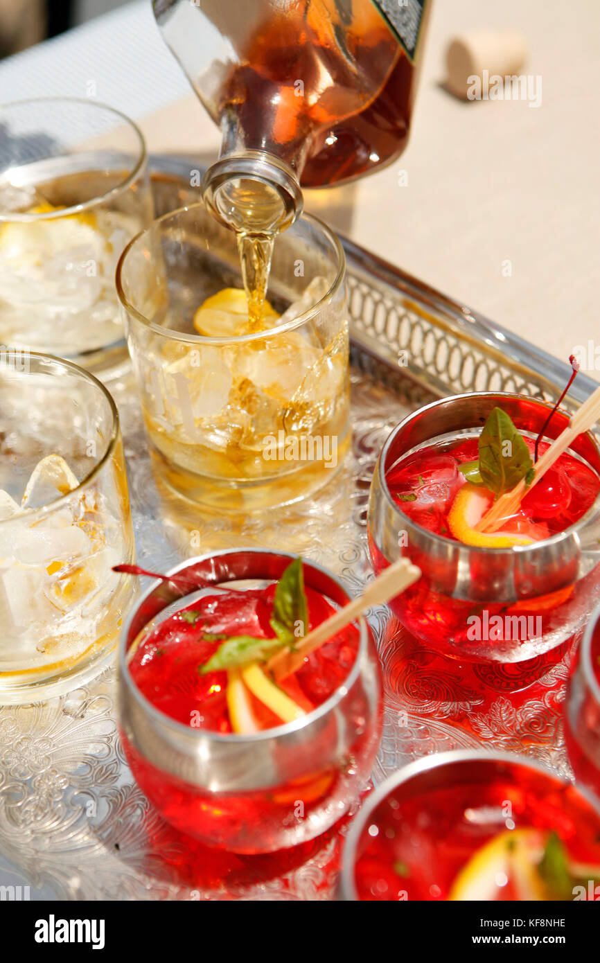 USA, Tennessee, Nashville, Iroquois Steeplechase, drinks on a tray, Moonshine Cherry-Basil Blush and Tennessee Whiskey - Stock Image