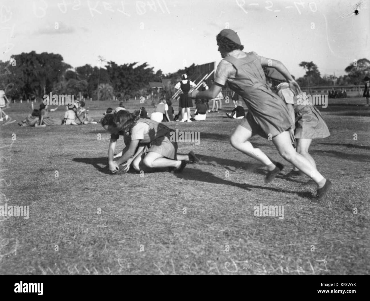 1 105228 Girls Wrestling Over The Ball During A Netball Game In Stock Photo Alamy