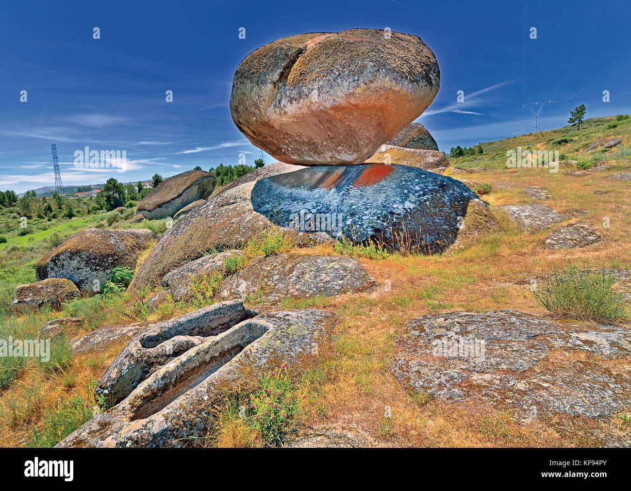 Ancient rock and sepulchres of Necropole de Sao Gens - Stock Image