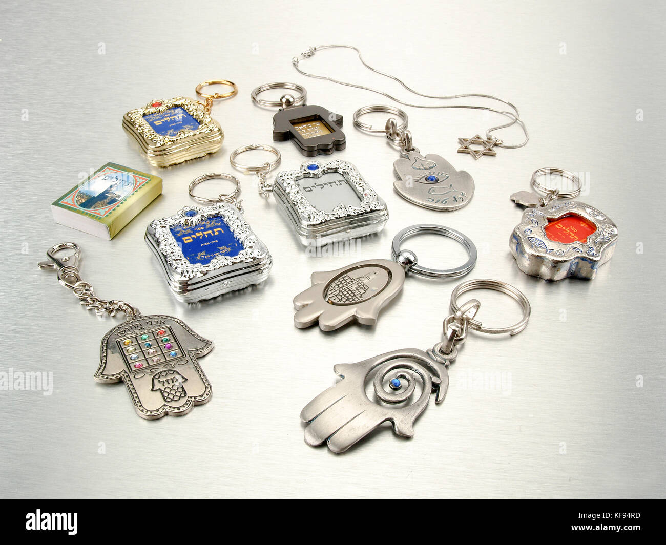 Small Judaica symbols, Humsa, Magen David, and Tehilim on silver background all popular amulets for protection from Stock Photo