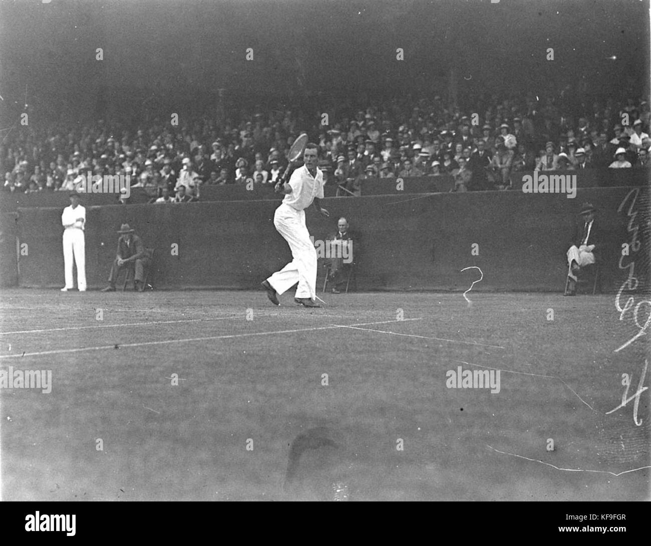 7817 English ace Fred Perry in action centre court White City - Stock Image