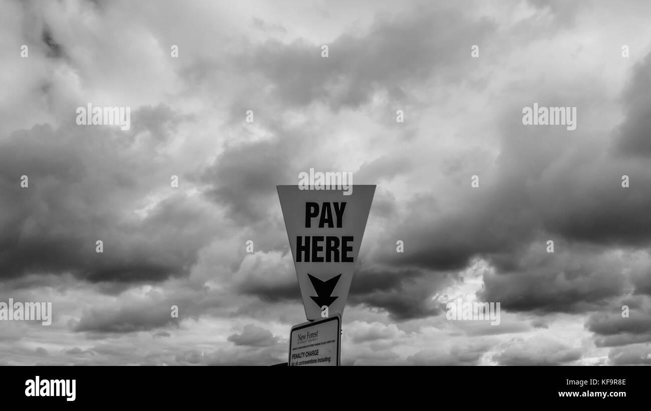 Ominous looking skies hang above a parking meter! - Stock Image