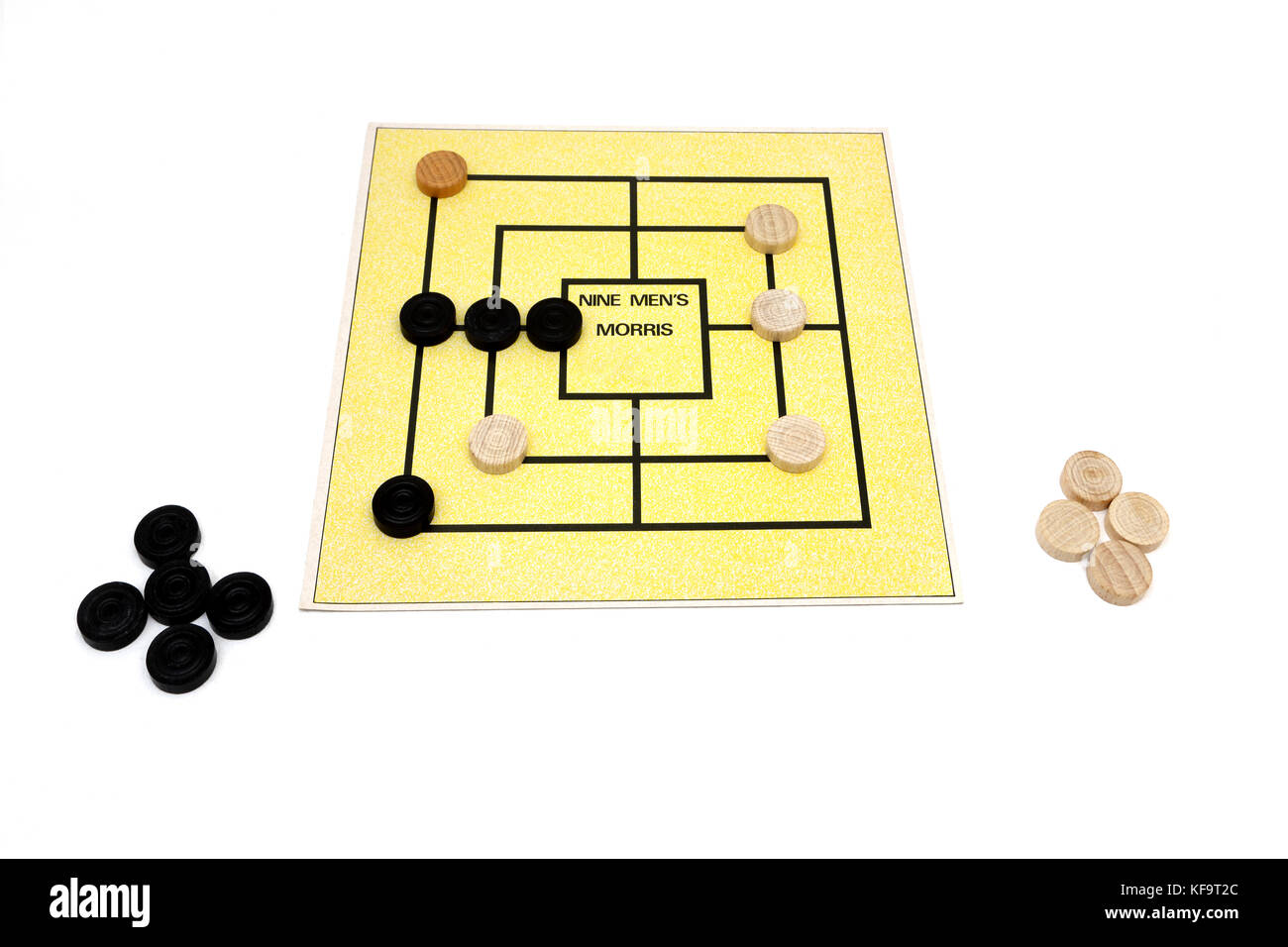 Nine Men's Morris Board Game and Pieces - Stock Image