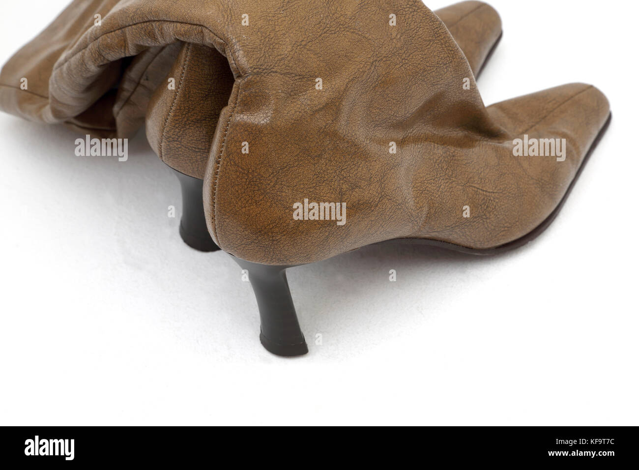 Brown Leather Knee High Boots With High Heels - Stock Image