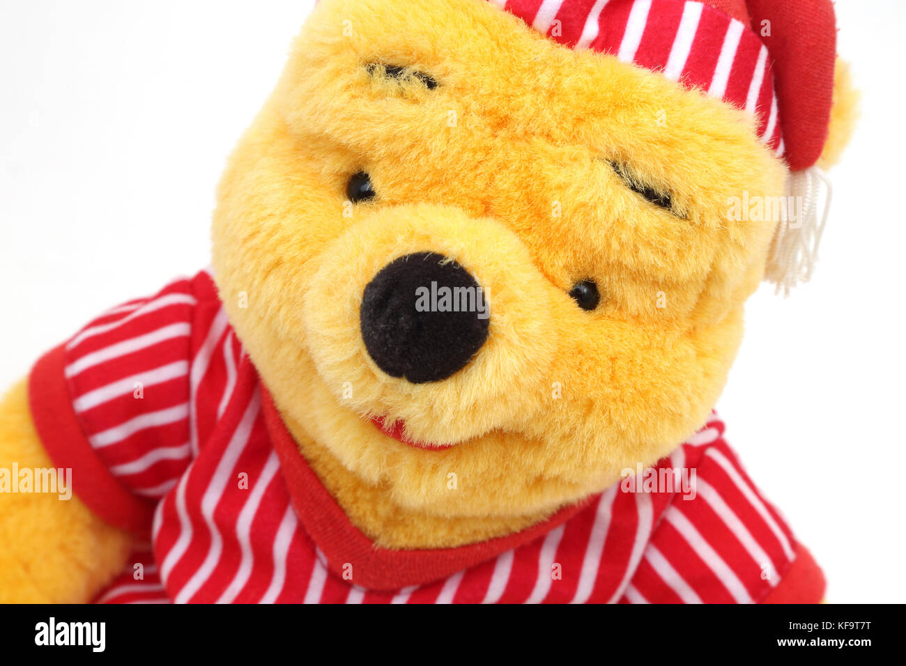 Disney's Winnie The Pooh In Night Clothes Soft Toy - Stock Image