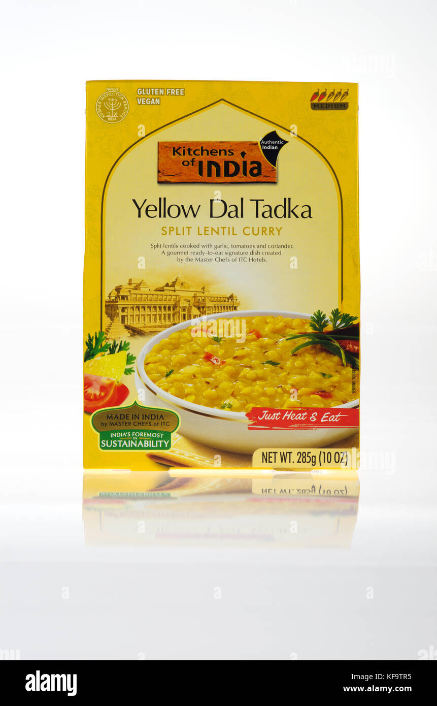 Box of prepared Indian Food Yellow Dal Tadka from Kitchens of India brand split lentil curry - Stock Image