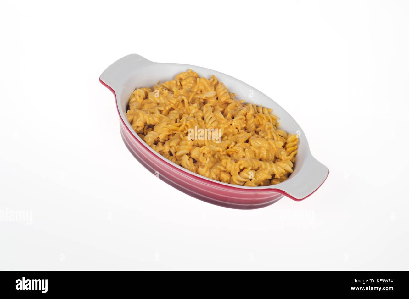 Macaroni Pasta and cheese in stoneware dish - Stock Image