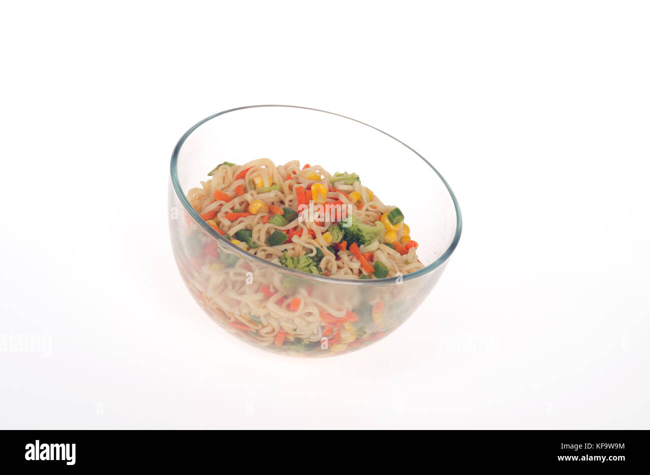 Bowl of vegetables with ramen noodles - Stock Image