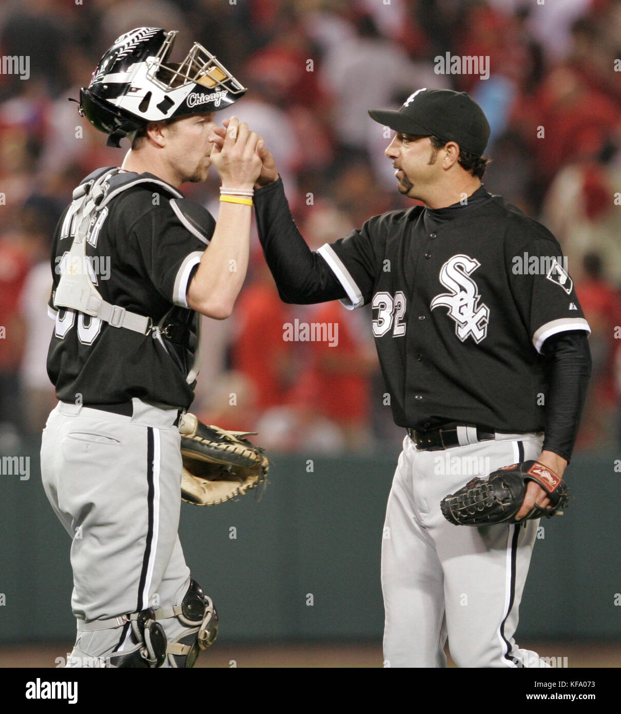 Chicago White Sox relief pitcher Dustin Hermanson, right, is congratulated by catcher Chris Widger after his save - Stock Image