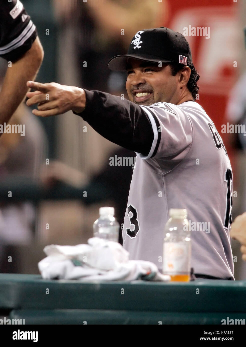 Chicago White Sox manager Ozzie Guillen points to the field before a baseball game against the Los Angeles Angels - Stock Image