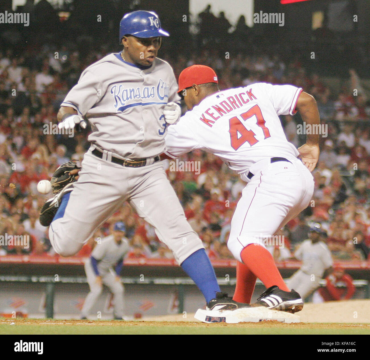 Los Angeles Angels second baseman Howie Kendrick, right, can't field an errant throw by third baseman Chone - Stock Image