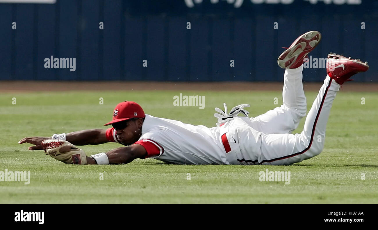 Fresno State's Ozzie Lewis makes a diving catch on a fly ball hit by San Diego's Shane Buschini in the second - Stock Image