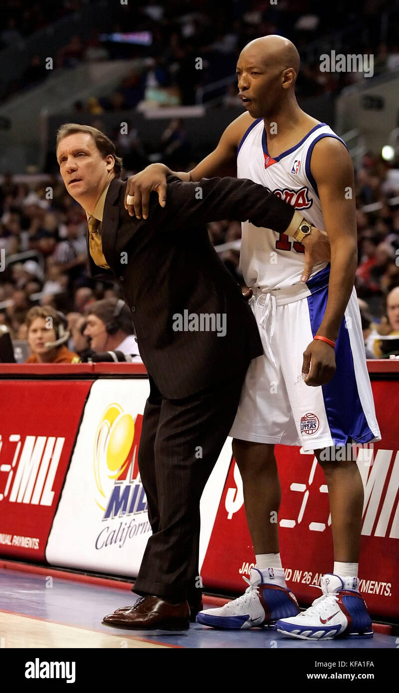 new style 9e26a 9cf33 Detroit Pistons head coach Flip Saunders, left, demonstrates on Los Angeles  Clippers  Sam Cassell on how his players are being fouled to referees in  the ...