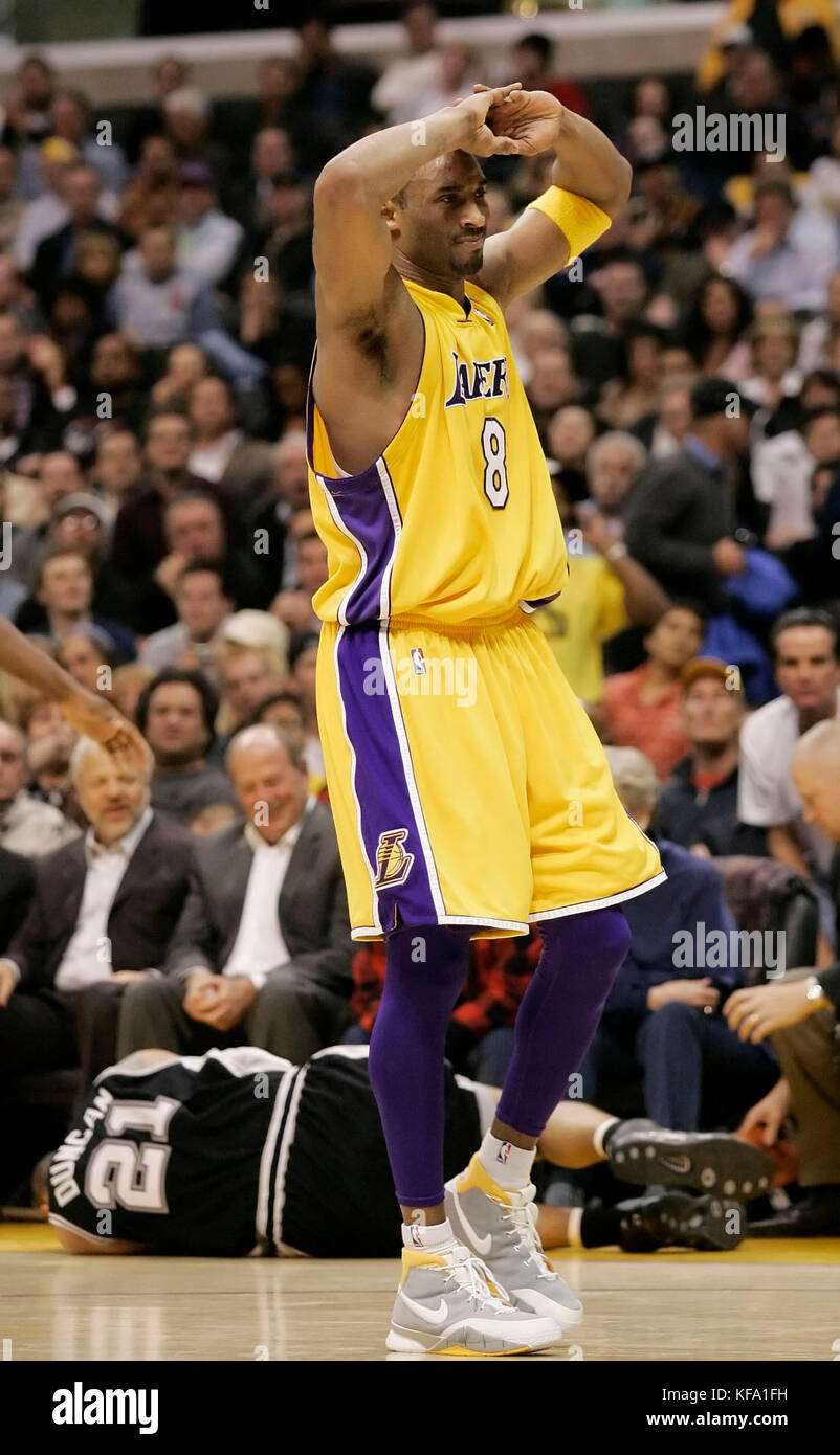 b26818fe4 Los Angeles Lakers  Kobe Bryant puts his hands to his head after colliding  with San