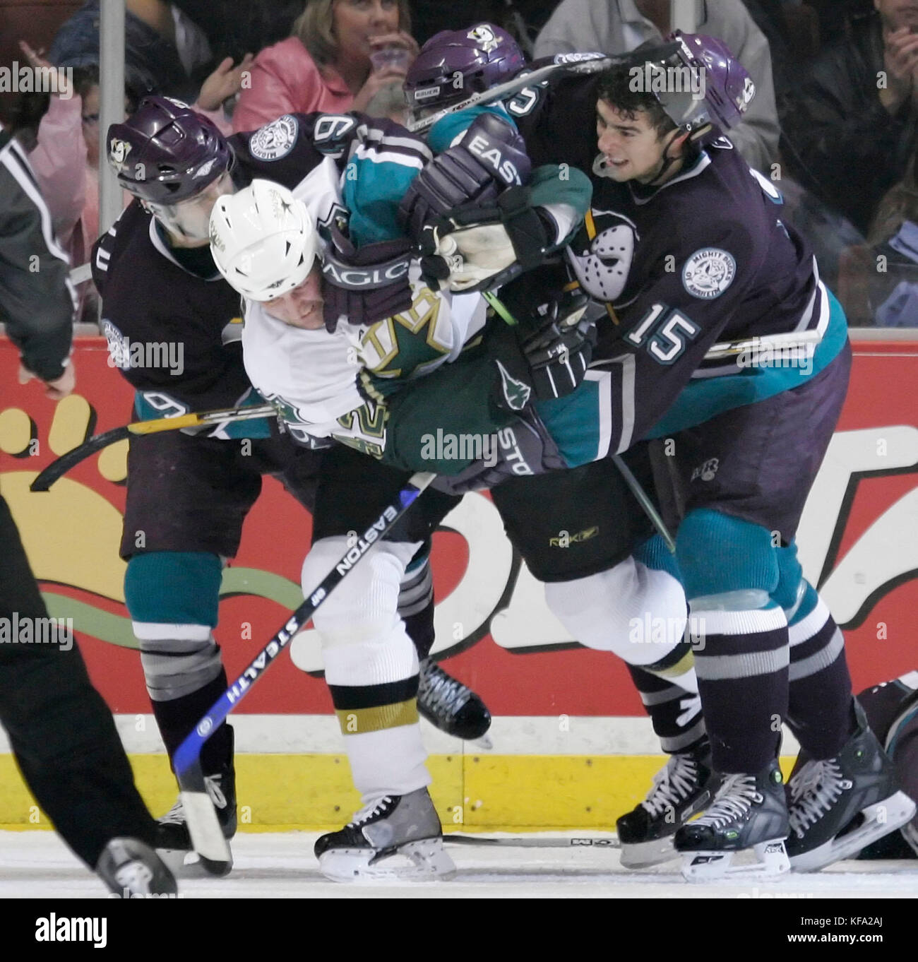 Anaheim Mighty Ducks' Joffrey Lupul, right, and teammate Andy McDonald, left, tackle Dallas Stars' Don Klemm - Stock Image
