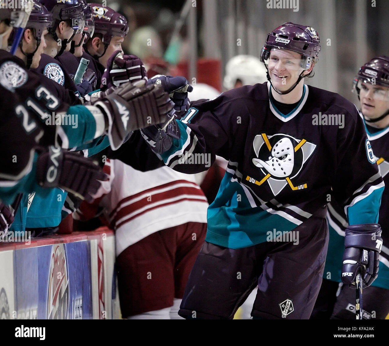 Anahiem Mighty Ducks' Corey Perry, right, celebrates his third period goal against the Phoenix Coyotes with - Stock Image