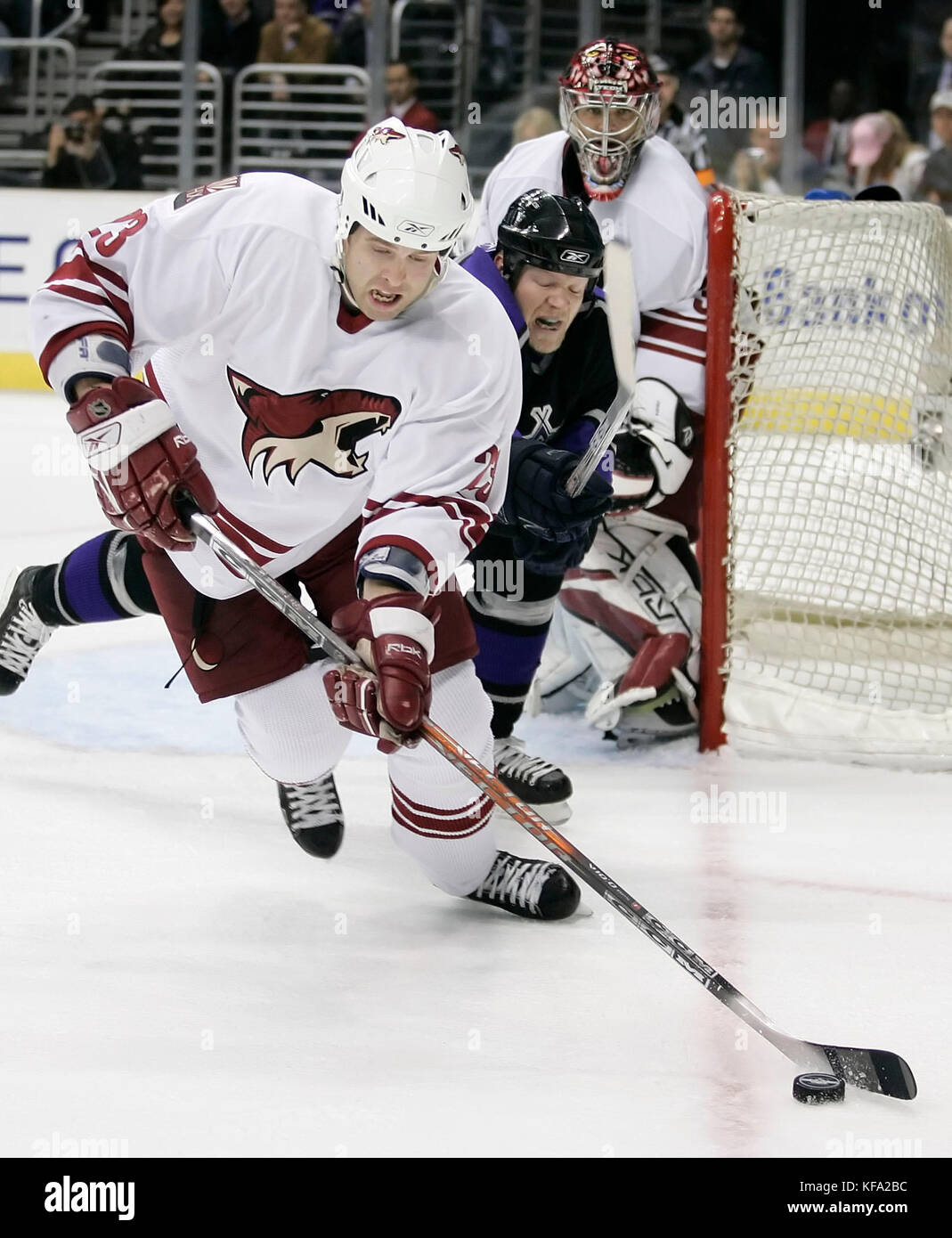 Phoenix Coyotes Paul Mara Foreground Clears The Puck Away From