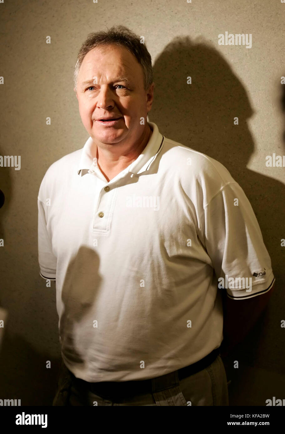 Anaheim Mighty Ducks head coach Randy Carlyle speaks to the media after a team workout in Anaheim, Calif. on Saturday, - Stock Image