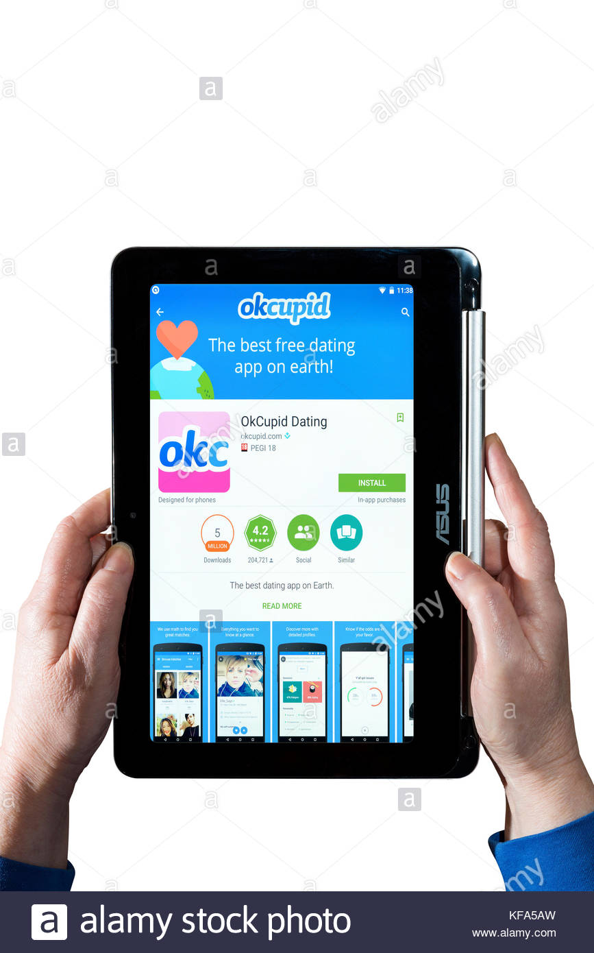 okcupid, dating app being used by a woman holding a Chromebook  Cut