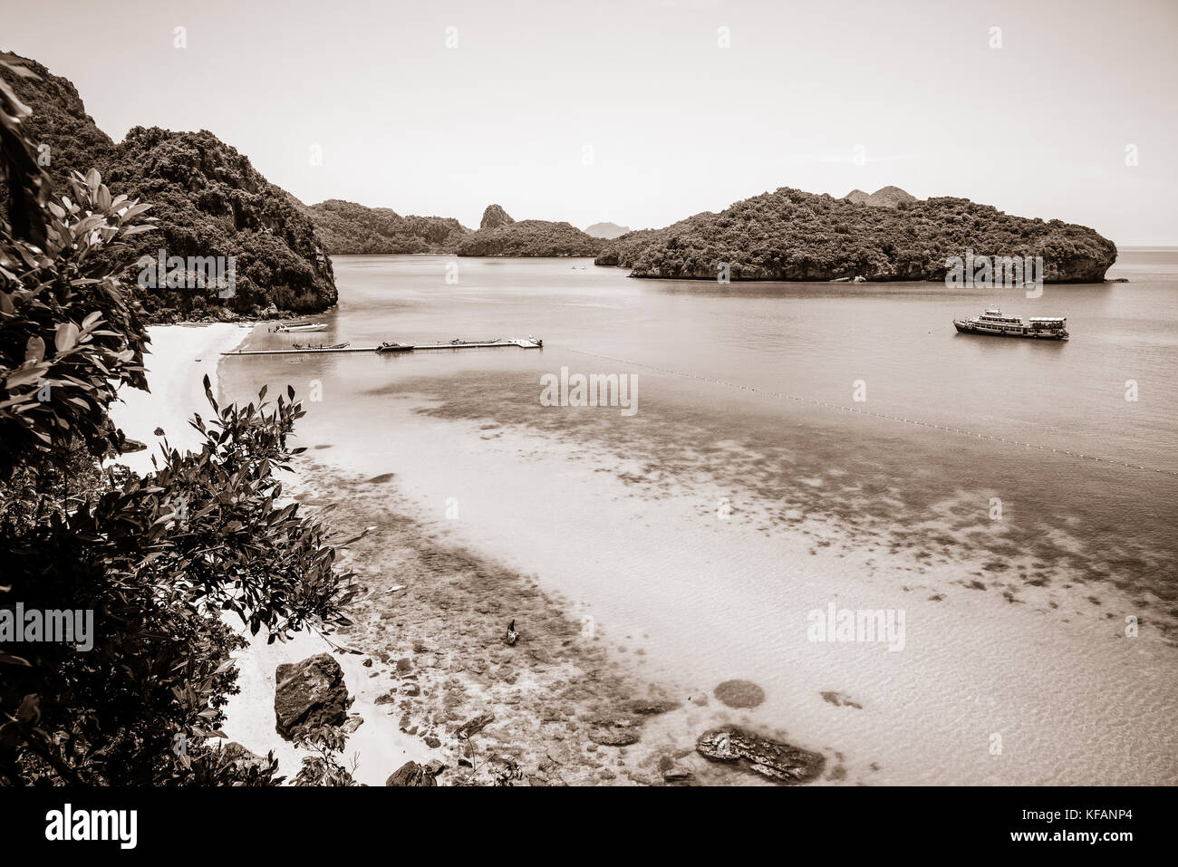 Sepia color light brown two tone, high angle view beautiful natural landscape of the beach, floating pier and sea - Stock Image