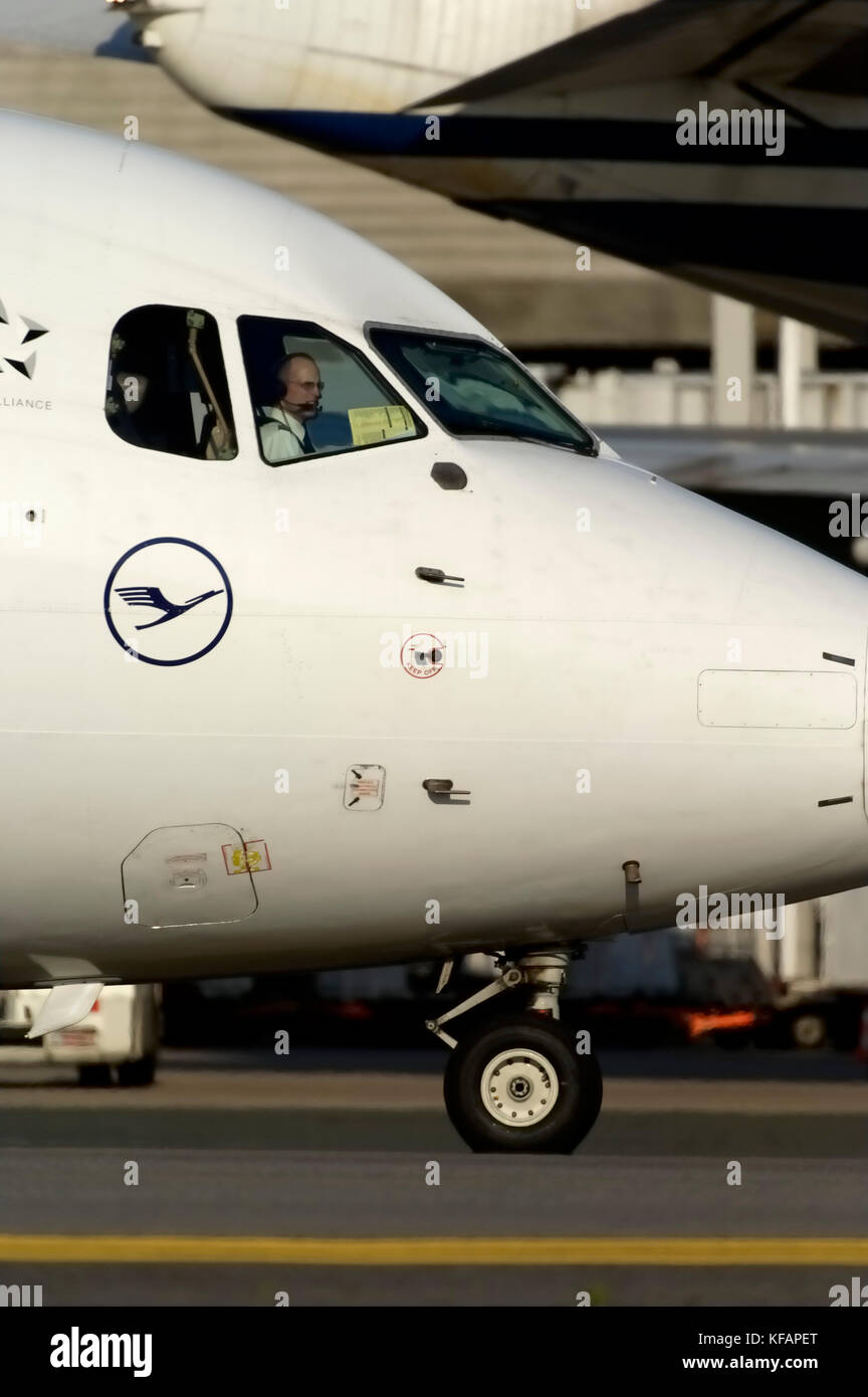 nose-undercarriage and nose with logo taxiing with co-pilot visible through the windshields - Stock Image
