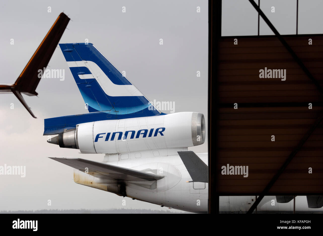 winglets, tail and CF6-80C2D1F engine on a Finnair McDonnell Douglas MD-11 outside hangar Leko 7 at Finnair Technical - Stock Image