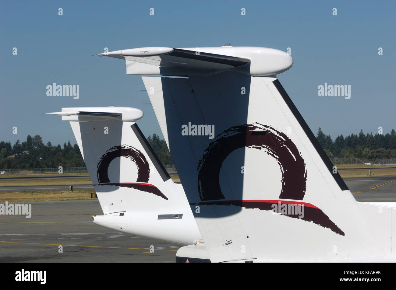 tail-fins of Horizon Air Bombardier DHC-8 Dash 8-400 Q400s - Stock Image