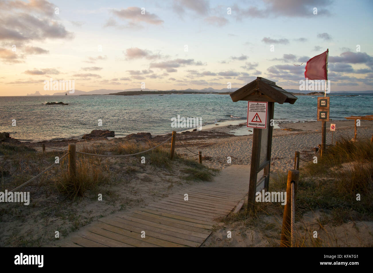 Espalmador island from Es Pas at sunset with Es Vedrá and Ibiza islands in the back at Ses Salines Natural - Stock Image