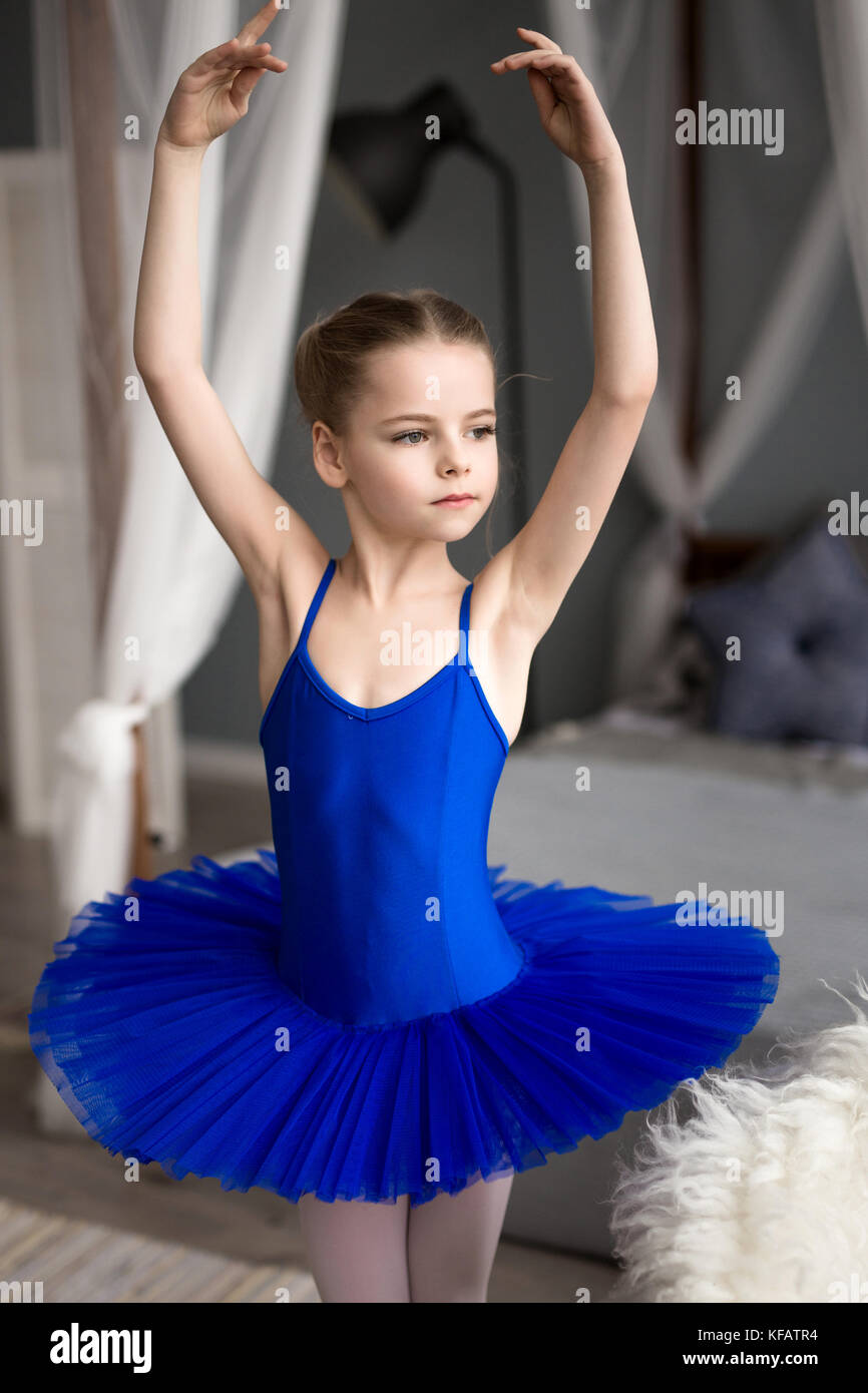 Cute little girl dreams of becoming a ballerina. Child girl in a pink tutu dancing in a room. Baby girl is studying ballet.  sc 1 st  Alamy & Cute little girl dreams of becoming a ballerina. Child girl in a ...