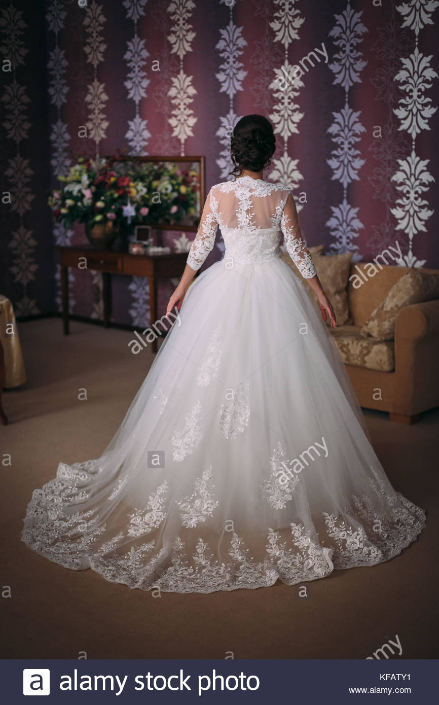 Beautiful Bride Brunette In A Long Wedding Dress In A Classic Stock