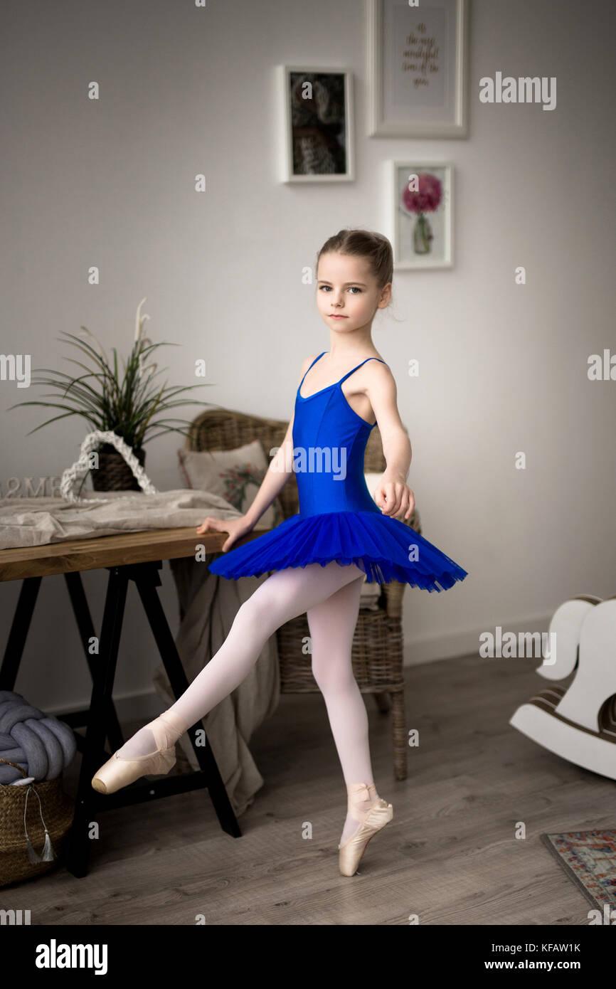 Cute little ballerina in pink ballet