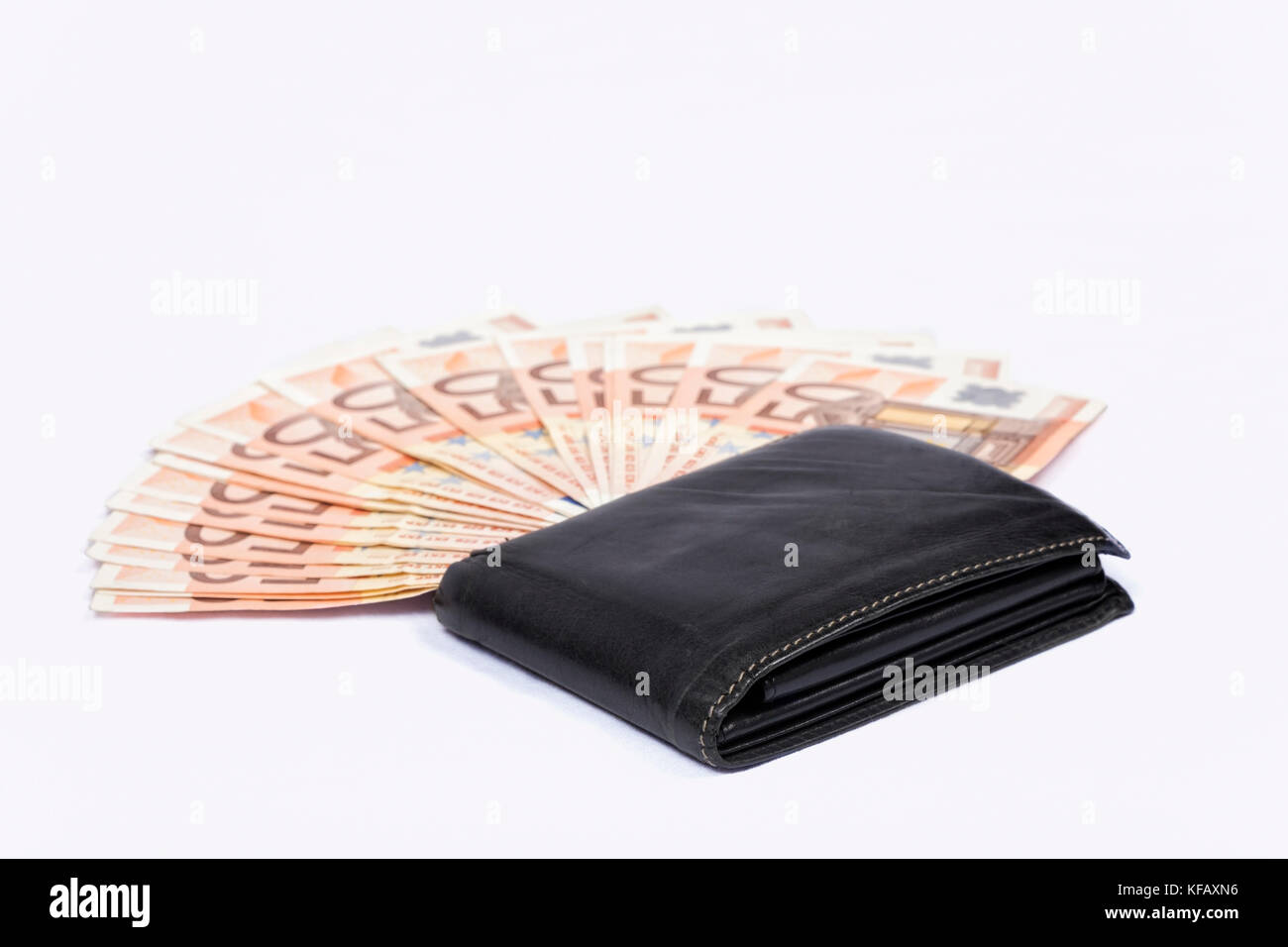 Wallet with money on white background. Euros. - Stock Image