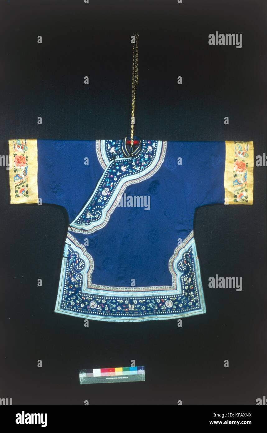 China, nineteenth century. Blue silk dress with floral band. - Stock Image