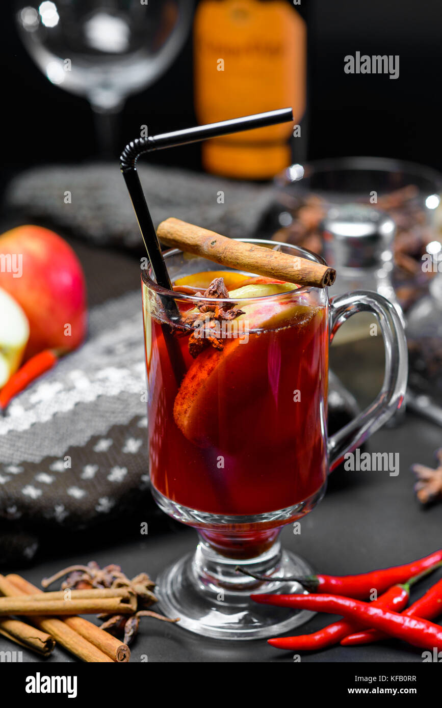 Mulled wine on a dark background - Stock Image