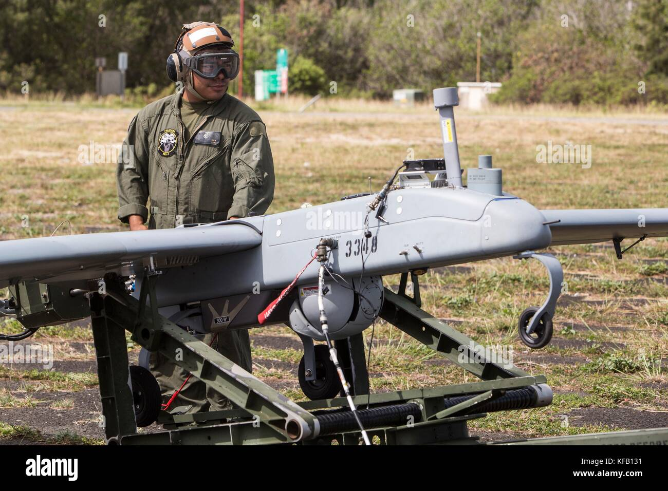 A U.S. Marine Corps AAI RQ-7B Shadow unmanned aerial vehicle is launched into the air during a training event at - Stock Image