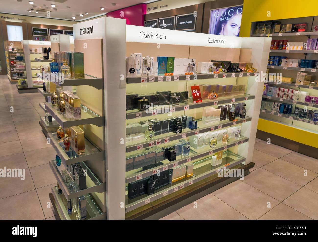 SKOFIJE, SLOVENIA - SEPTEMBER 21, 2017: Calvin Klein and Roberto Cavalli parfumery store shelf in Travel Free bordershop. It is a highway retail outle Stock Photo
