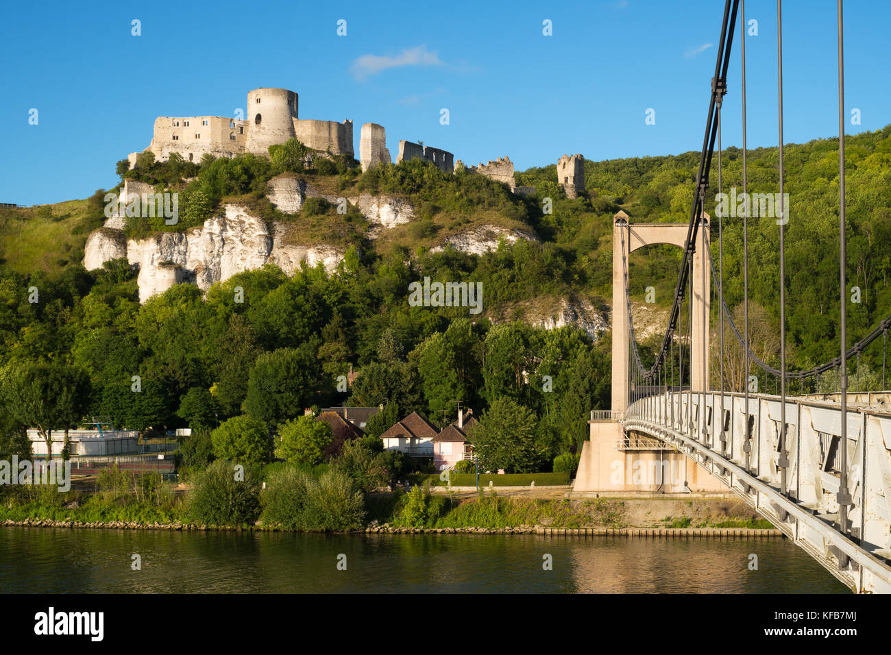 Château Gaillard, a ruined medieval castle, seen from Andelys suspension bridge across the river Seine, Les Andelys, Stock Photo