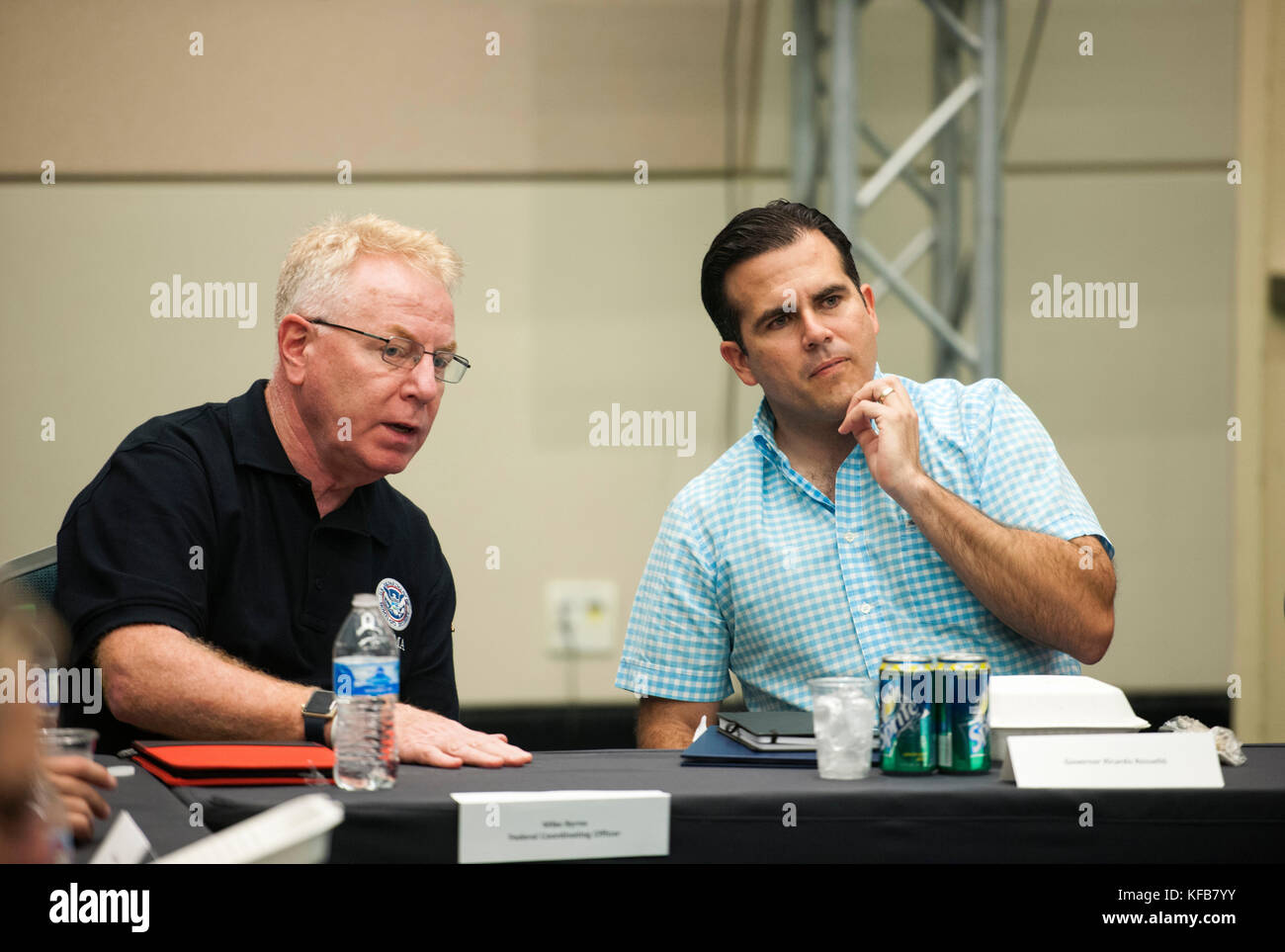 Federal Emergency Management Agency (FEMA) Federal Coordinating Officer Michael Byrne (left) meets with Puerto Rican - Stock Image