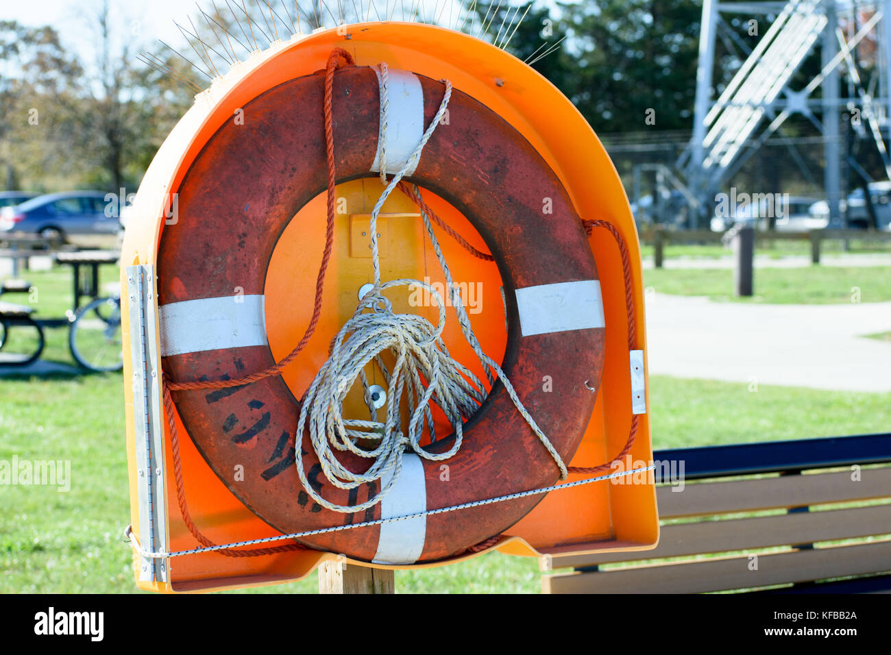 Life ring in plastic housing along the Cape Cod Canal in Sandwich MA. - Stock Image